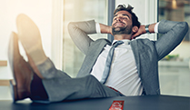 Man lounging in office chair